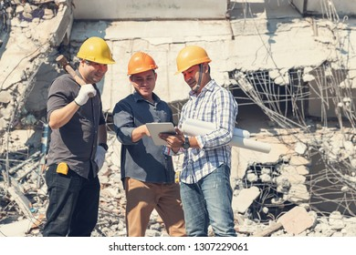 Engineer architect and worker operation control demolish old building.