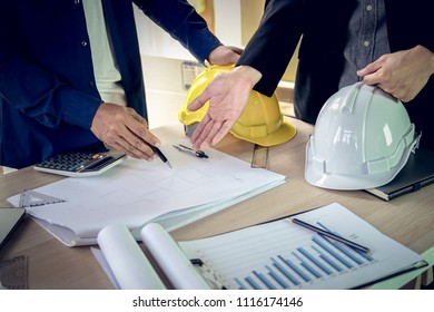 Engineer and architect working document about progress of work schedule and construction drawing on the site