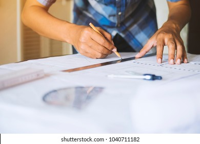 Engineer architect working pointing project drawing construction planning blueprint design table in the office workplace