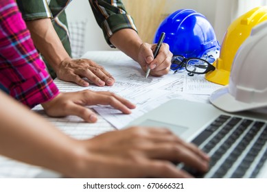 Engineer Architect working table with safety helmet,Engineer in working on computer laptop in office.