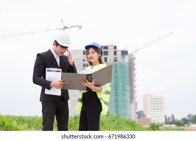 Engineer and architects discussing draft of new construction.