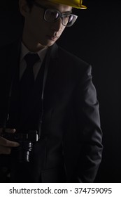 Engineer in black suit on isolated black background