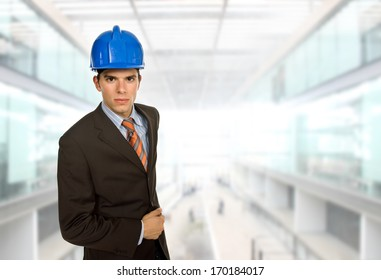 An engineer with blue hardhat at the office