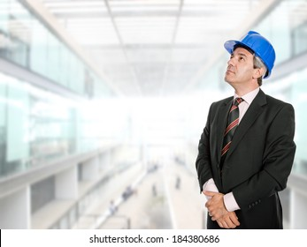 An engineer with blue hat at the office