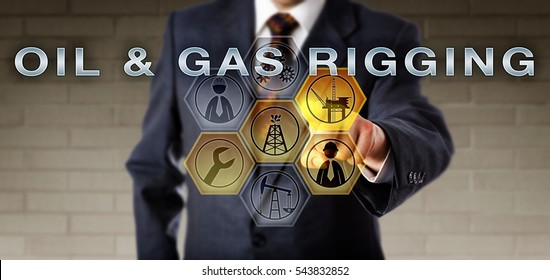 Engineer in blue suit activating OIL & GAS RIGGING on a virtual control screen via touch. Fossil fuels metaphor and energy industry concept for equipment and operations deployed to drill a wellbore.