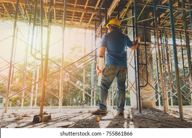 Maintenance supervisor images stock photos vectors shutterstock engineer with blueprint in building construction site malvernweather Image collections