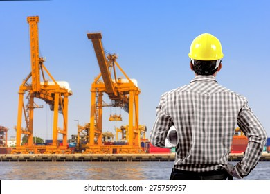 Engineer and blueprint for working at harbor