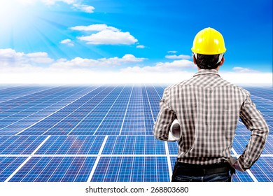 Engineer and blueprint for working at solar energy power plant against beautiful sky with in concept ecology