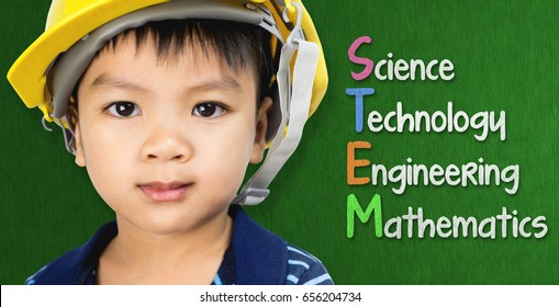 Engineer boy is studying STEM education on black board