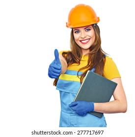 Engineer builder woman smile, hold business paper, show thumb. Builder uniform coveralls. Orange protective helmet.