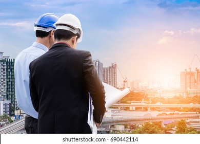 engineer and business man meeting and checking site outdoor business concept