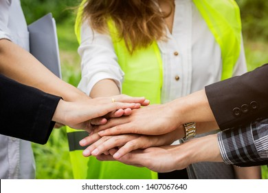Engineer and business teamwork join hands together. Business teamwork concept