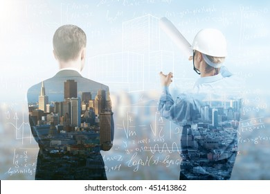 engineer and businessman looking to city under construction