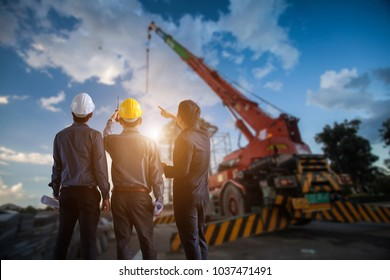 Engineer and businessman meeting, team discussion with construction on site work