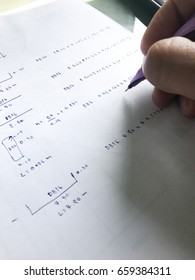 Engineer is calculating his work and writting