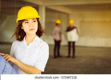 Engineer charming woman look outsite and holding blue print portrait.