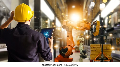 Engineer check and control automation robot arms machine in  modern warehouse industrial on real time monitoring system software. product inspection robotics. Network. Logistics and transportation.