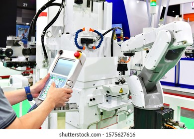 Engineer check and control automation white Modern Robot Arm system in factory, Industry Robot concept .