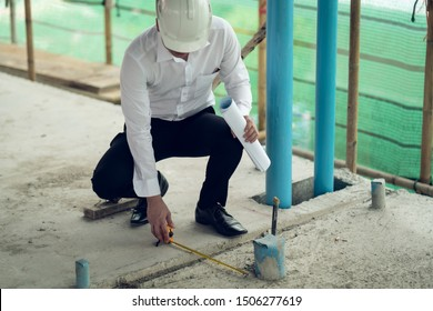 Engineer checking defect in construction site measure offset distance of sleeve of soil pvc pipe
