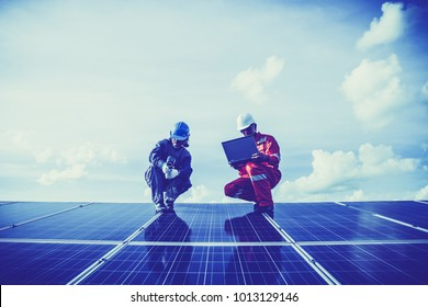 engineer checking heat of solar panel and using ir camera to scan heating of panel at solar power plant ; infrared camera using for checking and maintenance power plant of solar