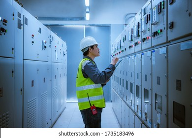 The engineer checking and inspecting at MDB panel.he working with electric switchboard to check range of voltage working in Main Distribution Boards factory.