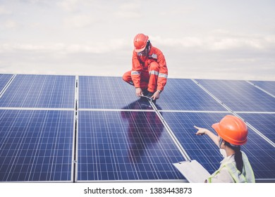 engineer checking job routine of labor working on cleaning solar panel at outside ; operation working on preventive and maintenance in solar power plant for great efficiency