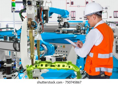 Engineer checking maintenance daily of automated automotive robotic in production line of automotive industry