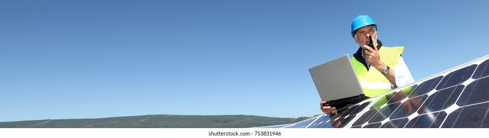 Engineer checking photovoltaic installation- banner template web