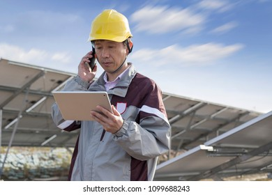 Engineer is checking photovoltaic panels