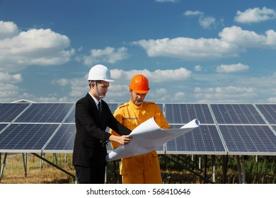 Engineer checking the solar panel. with blue sky and Cloud background