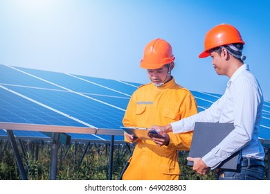 engineer checking solar panel in routine operation  at solar power plant
