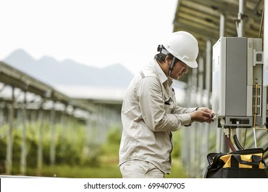 The engineer checks the electrical box in the solar photovoltaic area