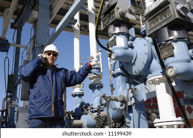 engineer in close-ups standing in front of fuel and oil station