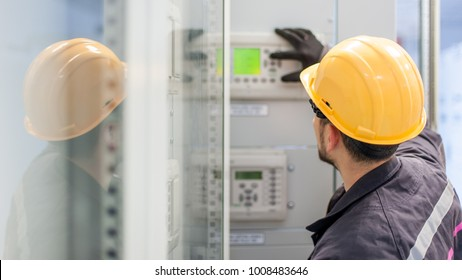 Engineer commissioning bay control unit. Engineering department. Medium voltage switchgear