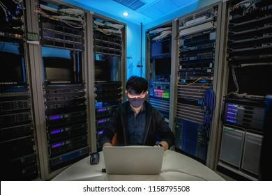 Engineer configure data center on laptop.