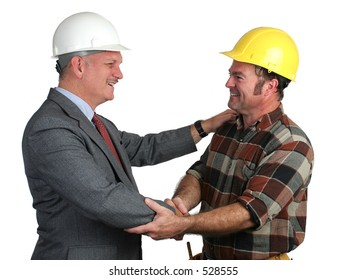 an engineer and a construction foreman greeting eachother warmly on the job