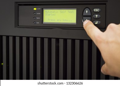 IT Engineer/ Consultant operate a large UPS power in a datacenter.