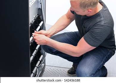 IT Engineer/ Consultant replace a large UPS / Uninterrupted Power Supply in a datacenter. Service on UPS.