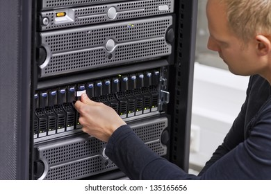 It engineer / consultant working in a data center. This enclosure is a SAN (storage area network) and servers at the top.