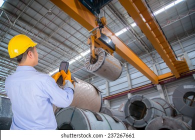 The engineer control the crane in the industrial