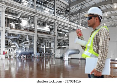 Engineer control working a boiler equipments and machinery in a modern thermal power plant industry