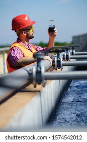 An engineer controlling a quality of water ,aerated activated sludge tank at a waste water treatment plant.  pollution