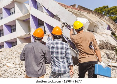 Engineer controls the work, smashing the building to create a new building