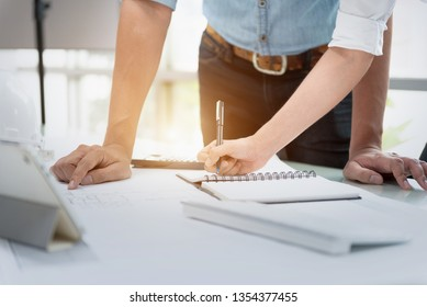 Engineer Designer People Drawing and Planning with Blueprint Architecture on Desk office. Drafting and Design Worksheets Before Startup Project Concept.