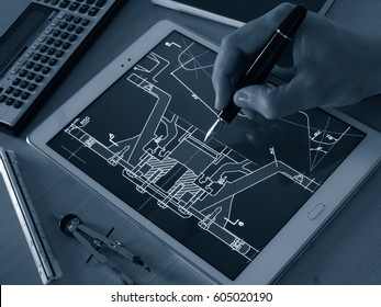 engineer designer working on cad blueprint using tablet computer tool