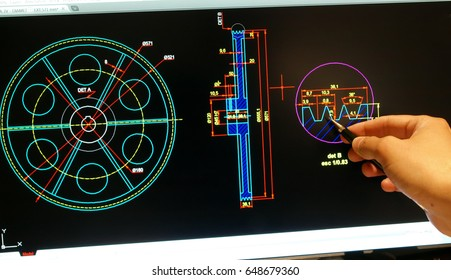 engineer designing on computer a mechanical piece detail