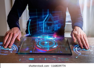 An engineer designs a high-energy house using sophisticated and futuristic programs with holography. Concept of: home, future, project and augmented reality.