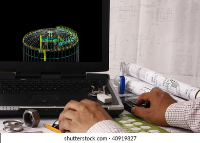 Engineer doing a 3d model review in his tank design - many uses in oil & gas industry.