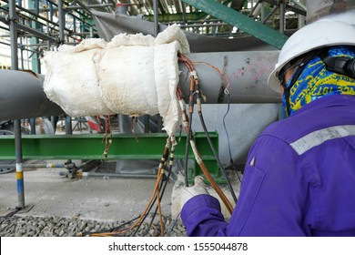 Engineer is doing hardness testing of alloy pipe and welding after a post weld heat treatment (PWHT)