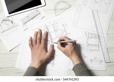 The engineer draw the building plans.